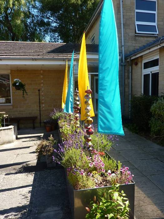 Yellow and blue flags marking garden boundary