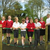 Children and teachers celebrate outstanding ofsted report