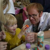 Child fascinated with a science experiment