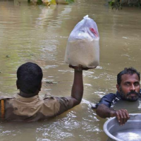 Two men up to their necks in flood waters