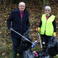 Bishop Robert and Pauline Farman litter picking