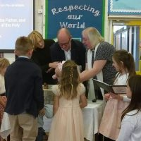 Baby Evie christened at school