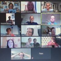 A Zoom screen with lots of friendly faces with Malc Allen at the centre