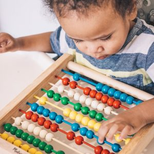 Toddler with an abacus