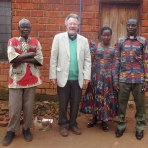 Eliazary and his parents with sponsor David