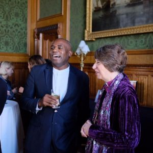 A laughing David Lammy MP in conversation with Bishop Rachel