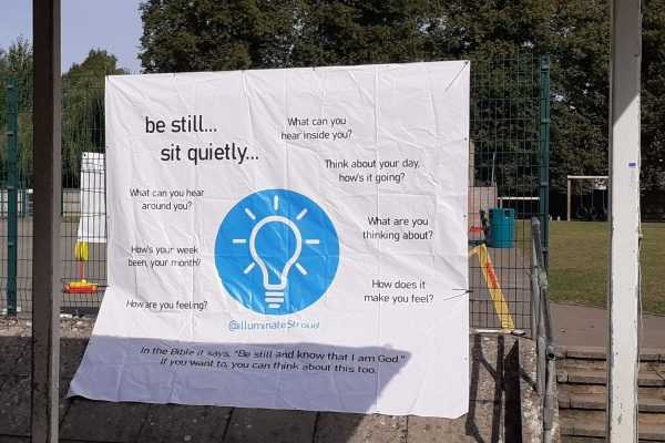 A poster showing a lightbulb with prompts to encourage people to listen, think and recognise feelings